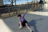 (Friday Jan. 6, 2006) Ellie Bain, 4, of Denver takes a tumble on the ice rink in Fillmore Plaza in...