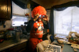 Norman 'Stormin' Norman' Silva (cq), 67, of Denver adjusts his oversize sunglasses and wig in the...