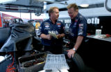(MORRISON, COLO., JULY 16, 2004)   Race car driver Jerry Tolilver, right, talks with Co-Crew...