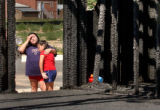 Greeley, Colo., photo taken July 18, 2004- Tessa Gonzales (RIGHT),11, hugs her mother Valerie...
