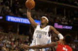 Denver Nuggets forward Kenyon Martin, left, is fouled hard by Toronto Raptors center Eric...