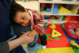 ***Season to Share***    One-year-old Jaylen Brown plays with his teacher, Carrie Aldrich (cq), at...