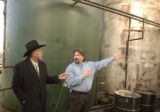 Ken Salazar gets a tour and explaination from Monte Malone, (cq), National Sales Manager, right...