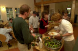Denver, Colo., photo taken June 27, 2004- Members of the Hearthstone community gather for a meal...