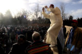 Karim Iraq (cq) photographs the festivities after Colorado Muslims prayed at the Masjid Abu Bakr...