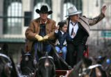 Stage coach driver Scott Smith, left, drives parade Grand Marshal Ex-Senator Ben Knighthorse...