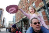 McKenna Wingate (cq), 5, doffs her hat while sitting on her father, Roger Wingate's (cq),...