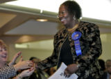 "Hazel Johnson Whittsett (cq) is congratulated by her ""enterouge"" during a dinner for..."