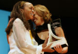 (left) Rachel Harding (cq) daughter of Rosmarie Freeney-Harding, is congratulated by Tamara Banks...