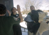 **1/24/06** AmeriCorps team leader Amanda Kurth, second from left, of Colorado Springs, gives a...