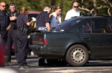 Aurora, Colo., photo taken July 2, 2004- Aurora police and crime lab personnel examine the back...