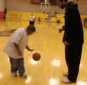 Kheri Davis, 12, (cq) left, gets some one on one instruction from Nene, taller to right with...