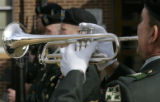 1SG (Ret) Ernie Mazurkiewicz (cq) plays Sounding of Taps at a memorial for SFC Eric Paul Pearrow,...