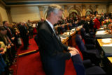 Colorado state senator Ron Teck, (R-Garfield/Mesa), prays as he begins his final session serving...