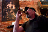 (Golden, CO. JULY 22, 2004) Coors employee Pat Greeno, of Arvada,  drinks a Coors beer with his...