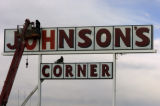 **1/26/06** Workers from Freeman Signs replace the lettering on one of the Johnson's Corner signs...