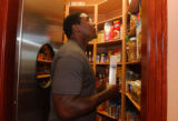(LONE TREE JULY 21, 2004)  Trevor Pryce takes a look threw his pantry as he may have discovered...