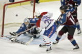Colorado Avalanche goaltender David Aebischer (#1) stops a shot by the Montreal Canadiens' Richard...