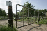 An ominous gate blocks access on JS Road south of  Glade Park, Colorado. The gate owned by actor...