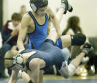 Ft. Lupton, CO Jan. 12, 2006 Dale Shull of Ft. Lupton controls Jake Steffens during their 103...