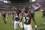 Denver Broncos wide reciever Todd Devoe, left, and running back Cecil Sapp, right, after defeating...