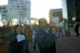 (1/12/06) Harold Lasso (with megaphone) leads the chanting of a group of immigrant rights...