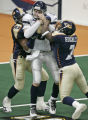 Chicago Rush quarter back Matt D'Orazio, middle, gets sacked by Colorado Crush defenders Anthony...
