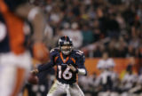 Denver Broncos #14-Jake Plummer reads the defense while he moves in the backfield against the New...