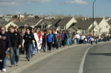 Walkers march along University Blvd. in Highlands Ranch Sunday afternoon January 15, 2006. The...