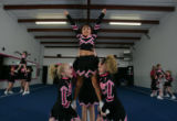 Young cheerleaders from TNT Explosions in Brighton rehearse their routine on January 25, 2005 for...