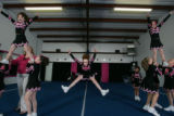 Cheerleader Bailey Evers, 10 (cq), in center, jumps during practice with TNT Explosions Youth...