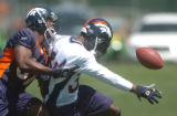 (CENTENNIAL COLO., May 9,2004) Broncos Willie Jackson (left) and  Kelly Herndon (right ) during...