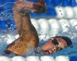 Kaitlin Sandeno, of the University of Southern California, makes her way through the water en...