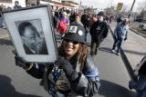 Freddie Johnson (cq) from Denver carries a picture of Martin Luther King Jr. as she marches  in...
