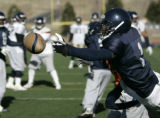 #1 Damian Harrell  goes for a pass as the Colorado Crush practice at Five Star Stadium in Adams...