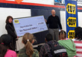 Best Buy district manager Jeff Fogelman presents a check for $10,000 to Kathy Luna,vice president...