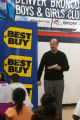 Best Buy district manager Jeff Fogelman talks to kids Monday, Jan. 16 2006, at the Denver Broncos...