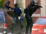 Denver, Colo., photo taken May 9, 2004-Denver police S.W.A.T  members get ready to enter an...