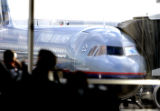 Passengers wait for a United flight on concourse B at DIA  Wednesday afternoon February 1,  2006.....