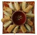 Super bowls filled with snacks for Superbowl Sunday.  Food shoot.   Egg rolls and dumplings. ...
