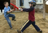 Cameron Davis, left, 7, and friend Jack Lang, 6, play with light-sabers in Highlands Ranch Monday,...