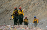 Patrick Craig,30, of Nederland, Colo.,front, leads a group of Wildland Colorado Fire Fighters from...