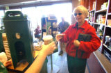 Joann Sullivan, of Denver stopped by the Starbucks for the nationwide coffee-give-a-way at the...