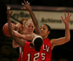 JPM226  University of New Mexico Lobos guard Julie Briody is swarmed by  University of Nevada at...