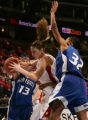 JPM729  University of Utah's Jessica Perry, middle, drives against Air Force Academy Lauren...