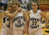 Moffat County High School girls players (left to right) Megan Winters, Angela Charchalis, and...