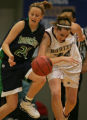 ThunderRidge Grizzlies Amanda Miller, left, tries to keep control of the ball while being defended...