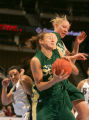 Vanessa Hutson, of BYU, left, Lindsay Thomas, center, and Marilyn Moulton, right, collide for a...