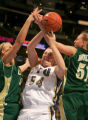 Casie Shepherd, left, Cassie King, center, and Marilyn Moulton, right fight for a rebound in the...