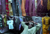 (Denver, Colo., photo taken 07/11/04) Sanna Kanuteh, business owner of African Cloths &...